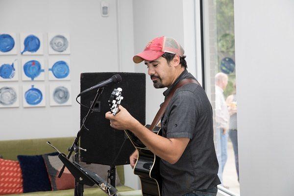 Tauvy Thomason playing the guitar